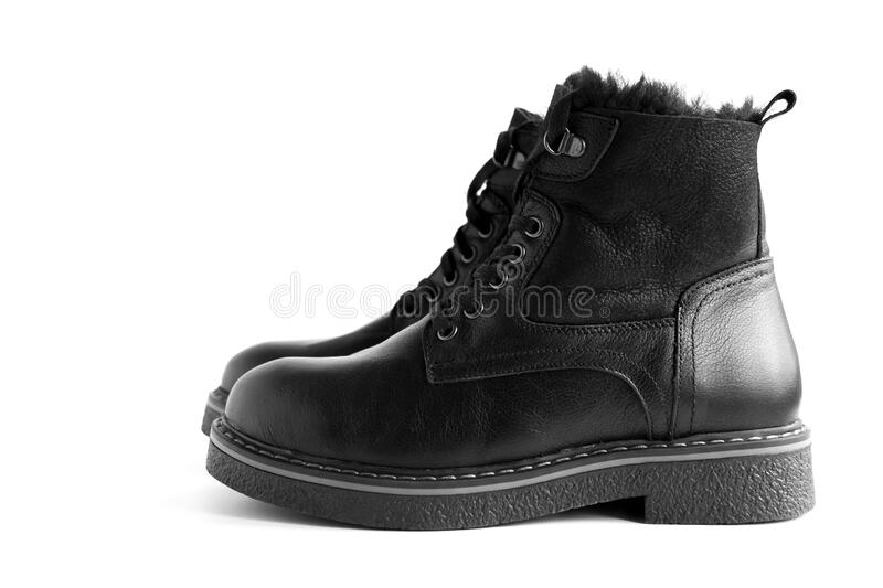 Isolated black leather women`s winter boots stock photography