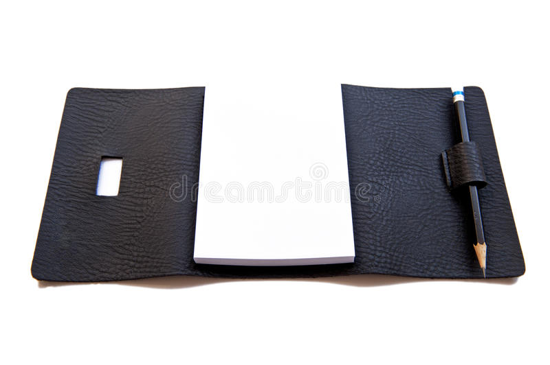 Isolated blank note book on white