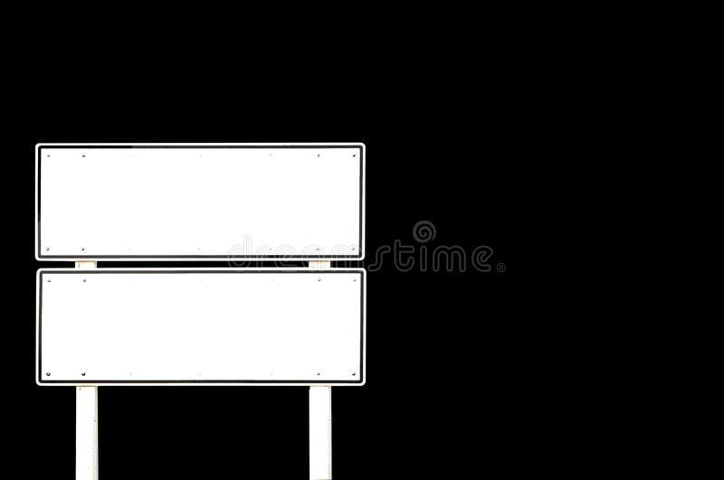 Isolated blank white double road sign pole on black background, Clipping path royalty free stock photo