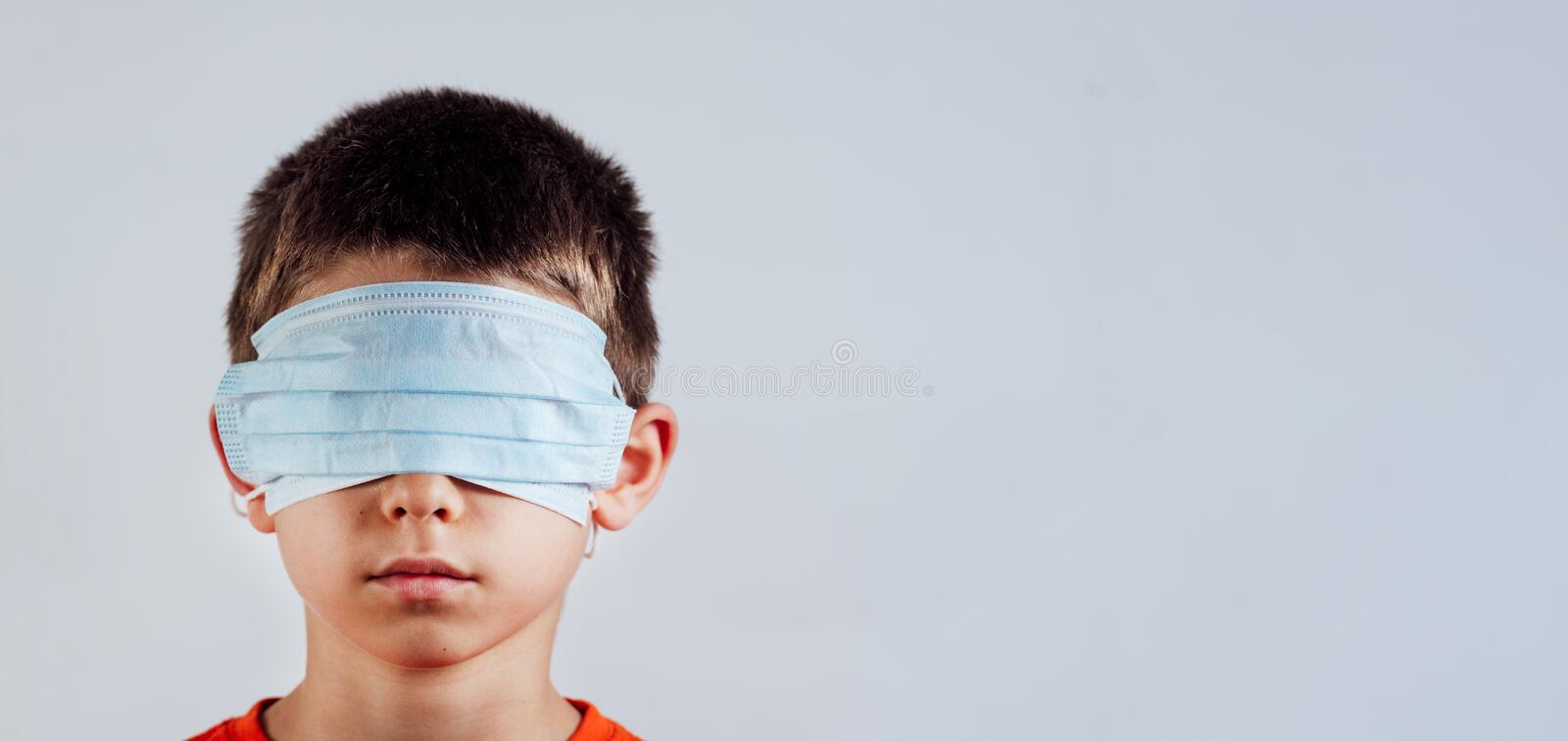 Isolated Blindfolded Child With Surgical Mask Over The Eyes And ...