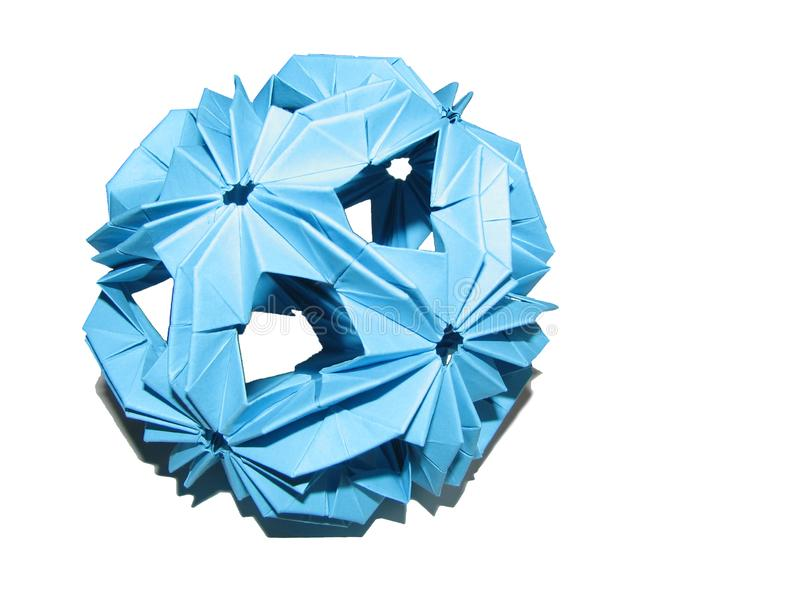 Isolated blue paper origami kusudama shape of sphere with shadow on white background stock image
