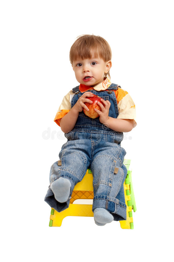 Isolated boy on chair stock images