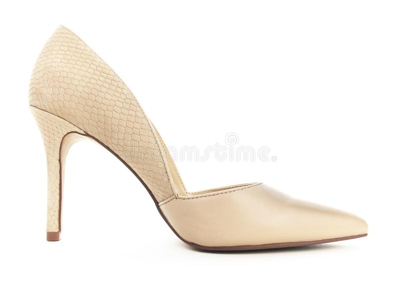 Isolated Brown Stiletto Heal. Fallen isolated beige fashionable stiletto heal on a white background royalty free stock images