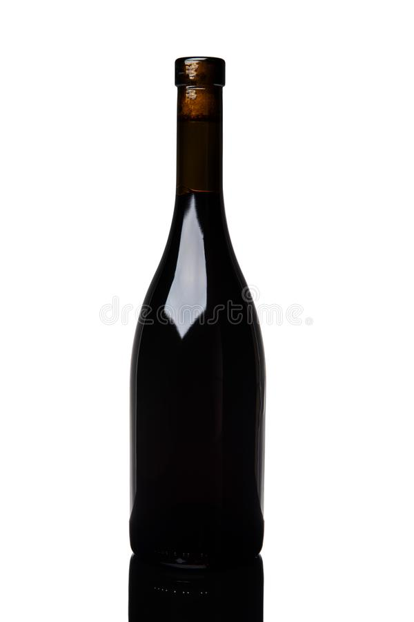 Isolated burgundy red wine bottle on white background. Alcohol, alcoholic, bar, beverage, black, celebration, closeup, concept, cork, dark, design, drink stock image