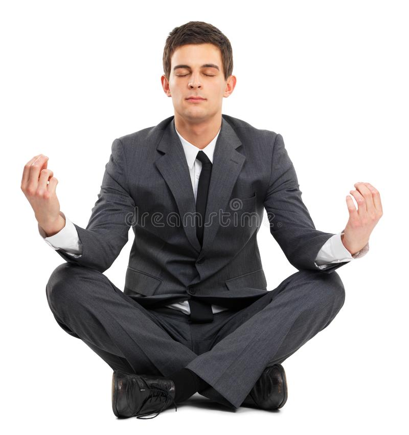 Isolated business man sitting in lotus position