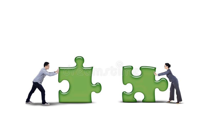 Download Isolated Business Partner Putting Together Two Puzzle Stock Image - Image: 35030245