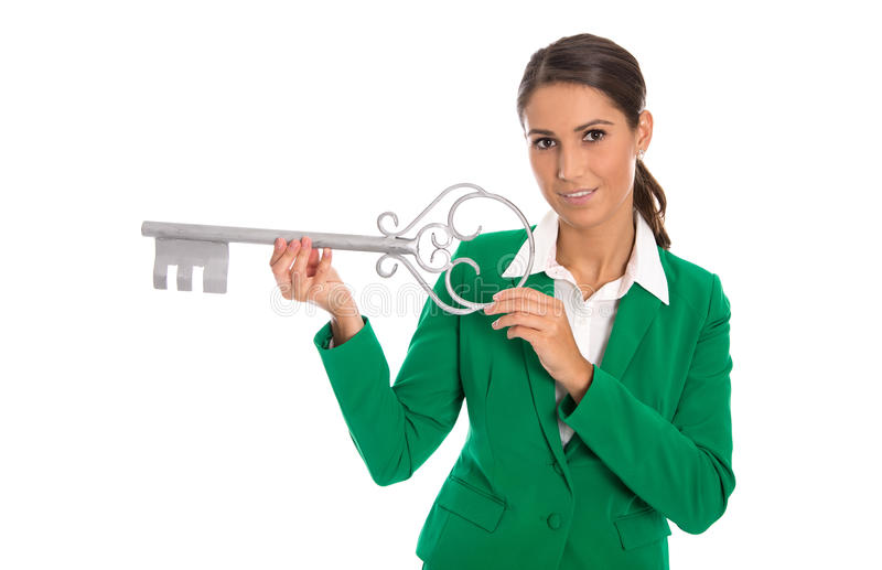 Isolated business woman in green holding key for dedicate a house. Isolated businesswoman in green holding key for dedicate a house or making housewarming party royalty free stock photography