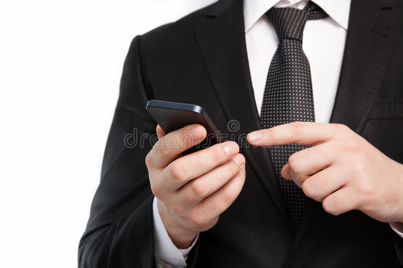 Isolated businessman in a suit holding a touch phone