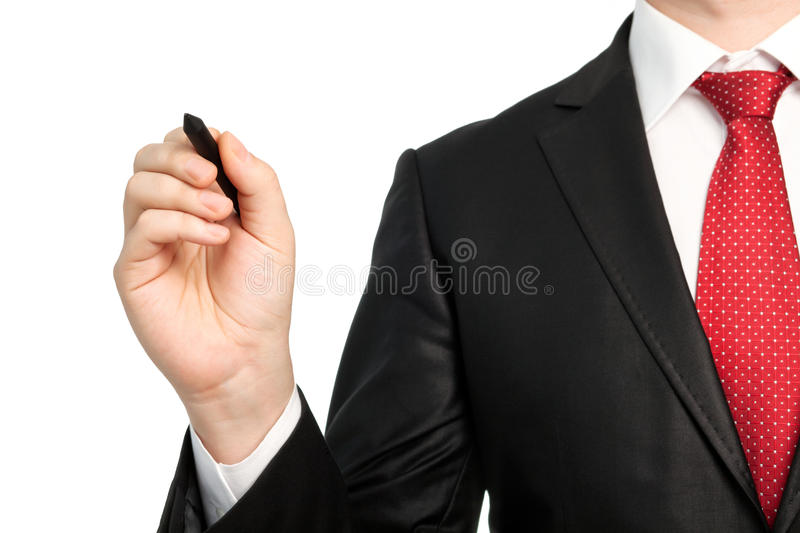 Isolated businessman in a suit with a red tie holding a pen royalty free stock photography