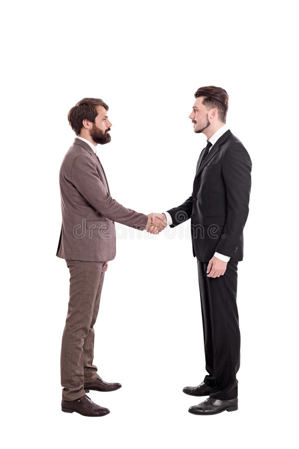 Isolated businessmen shaking hands stock photography