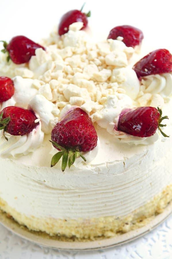 Isolated cake. Whole strawberry meringue cake on white background stock photos