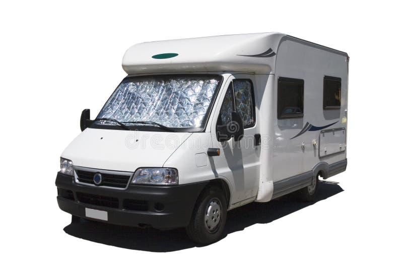 Isolated caravan. Isolaten caravan /Background:camping-car / Caravan at the campsite stock image