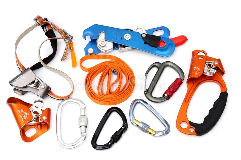 Rock Climbing Gear and speleology equipment. Isolated Rock Caving and climbing devices: ascender, descender, locking carabiners, quick ascender stock images