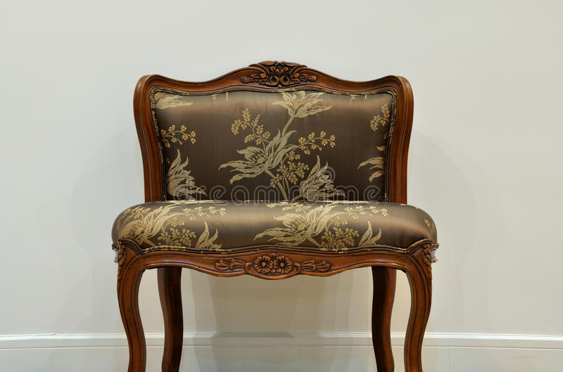 An isolated chair. A flowery and comfortable chair individual, shown as featured furniture or vacant position stock photo