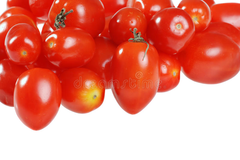 Isolated cherry tomatoes. On a white background royalty free stock photography