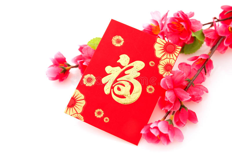Isolated Chinese New Year or Spring Festival objects. Chinese new year festival decorations, red packet and plum blossom isolated on white background. Chinese stock image