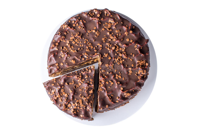 isolated chocolate layered cake with nougat and sponge cake in the cut on the plate, top view stock photos