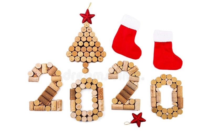 Isolated Christmas background made of wine corks. New Year 2020 isolated on white background stock image