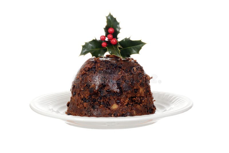 Isolated christmas brandy pudding on plate with holly stock images