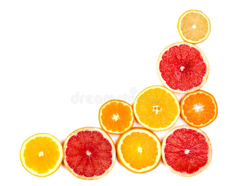 Isolated citrus fruits. Pieces of lemon, lime, pink grapefruit and orange isolated on white background, with clipping. Isolated citrus ts. Pieces of lemon, lime royalty free stock photography