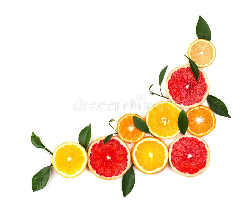 Isolated citrus fruits. Pieces of lemon, lime, pink grapefruit and orange isolated on white background, with clipping. Isolated citrus ts. Pieces of lemon, lime royalty free stock photo