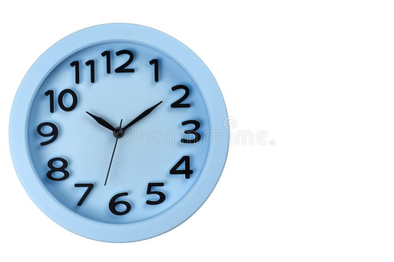 Close-up of the blue clock face with three-dimensional numbers. Isolated stock photos