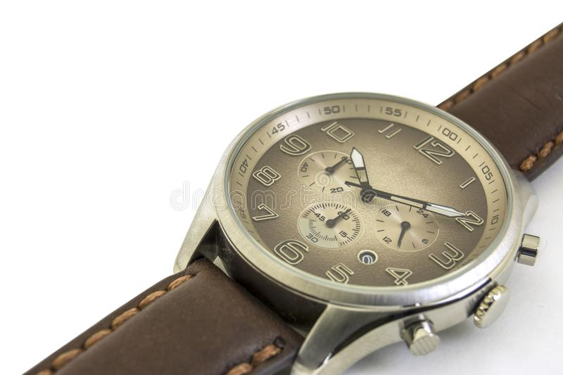 Isolated. Close up. Men`s watches are on a white background. Clockwise royalty free stock image