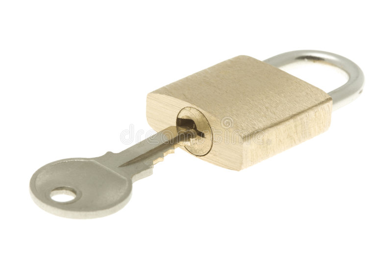 Isolated closed brass padlock with key about to op. Closed brass padlock with key about to open it. Isolated. Simply padlock for illustrating openness royalty free stock images