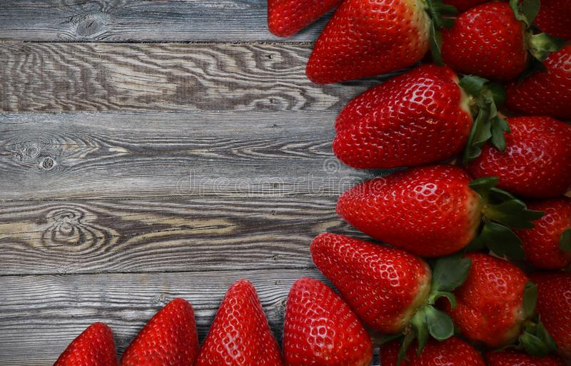 Closeup photo of a fresh strawberries on wooden table royalty free stock photos
