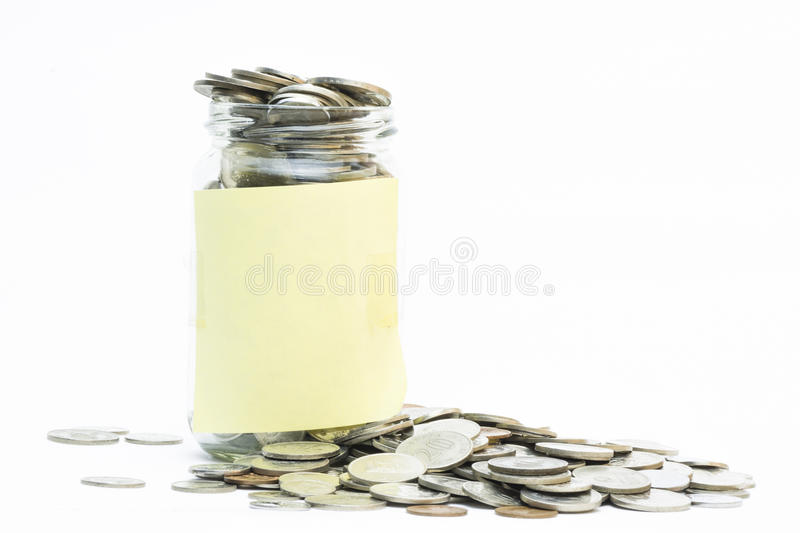 Isolated coins in jar with copy space. Financial ,business and welfare concept stock image