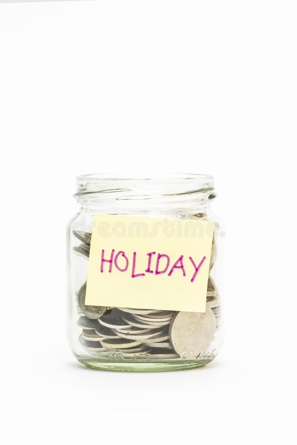Isolated Coins In Jar With Holiday Label Stock Photo