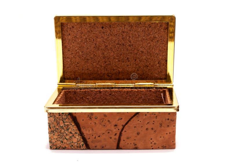 Isolated cork treasure box. Vintage cork treasure box waiting to be filled again royalty free stock image