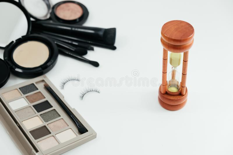 Isolated cosmetic equipment, powder, glasses, sand clock and watch on white background with copy space. image for. Isolated cosmetic object, powder, glasses royalty free stock photo