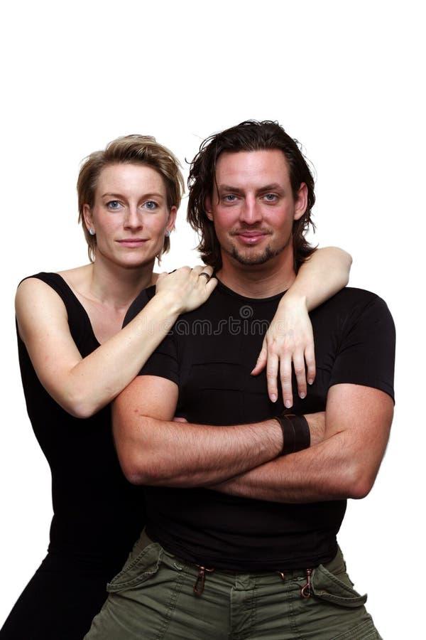 Isolated couple facing camera stock image