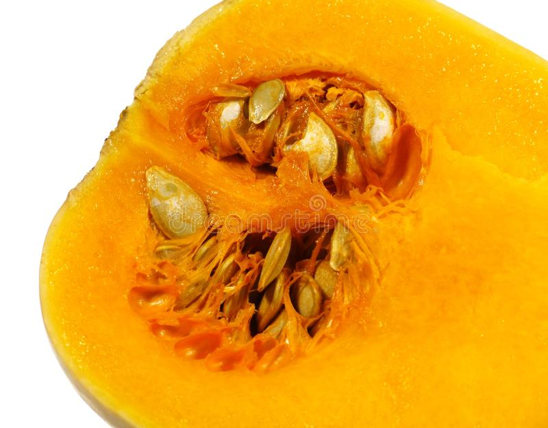 An isolated cut open bell pumpkin. A pumpkin butternut type or bell type (Cucurbita mochata) over white stock photography