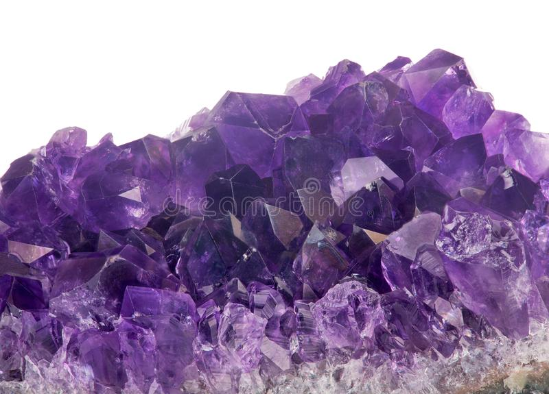 Isolated dark amethyst crystals group macro stock images