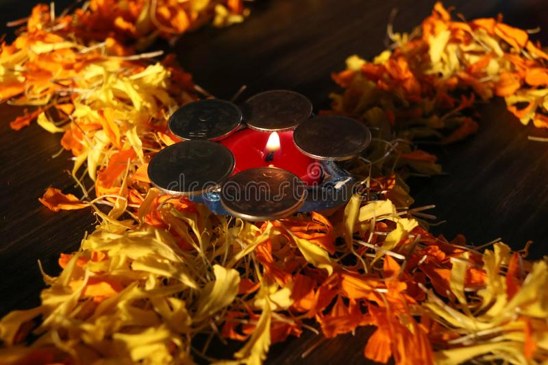 Dhanteras and diwali background.diwali greetings and wishes. Isolated diya/lamp placed on swastik for celebrating diwali and dhanteras festival in india stock photography