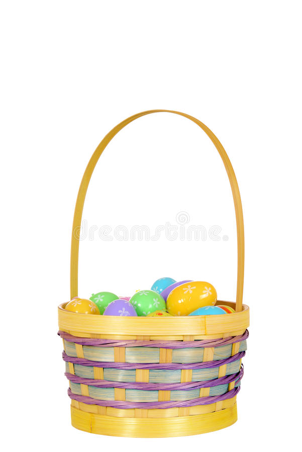 Isolated easter eggs in basket. On white background royalty free stock photos