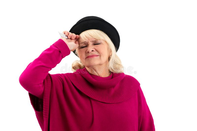 Isolated elderly woman with pills. royalty free stock photo