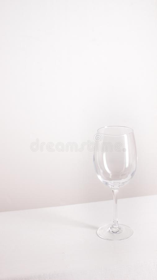 Isolated empty wine glass stands on gray background stock images