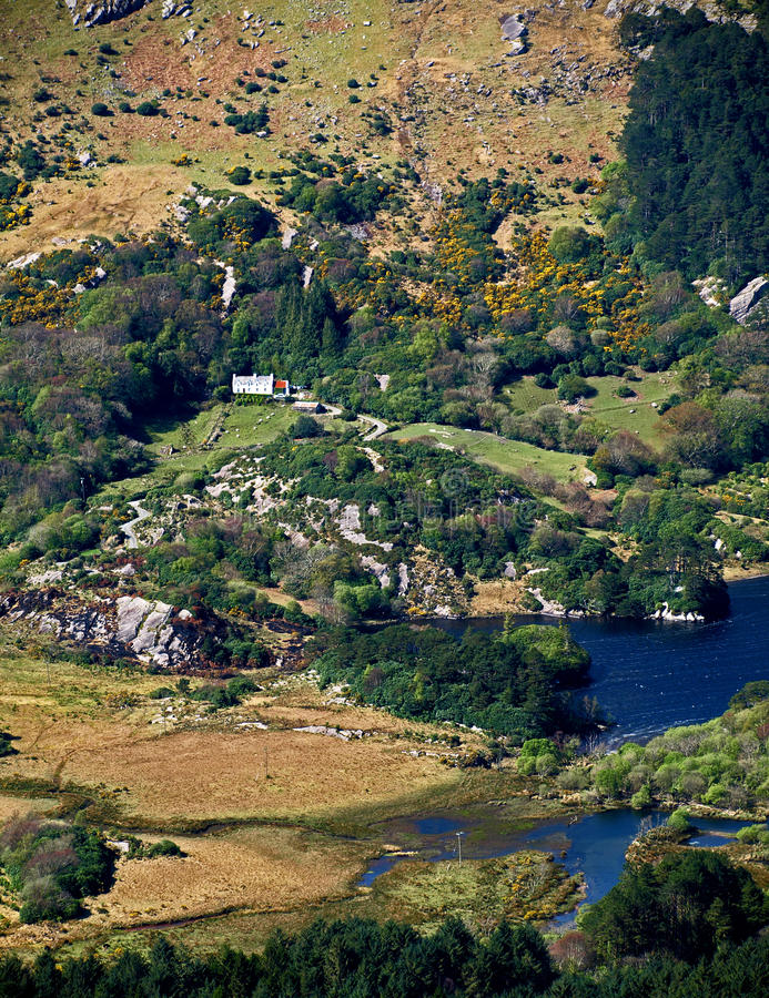 Isolated Farmhouse. Beside Glanmore lake from top of Healy Pass royalty free stock photography