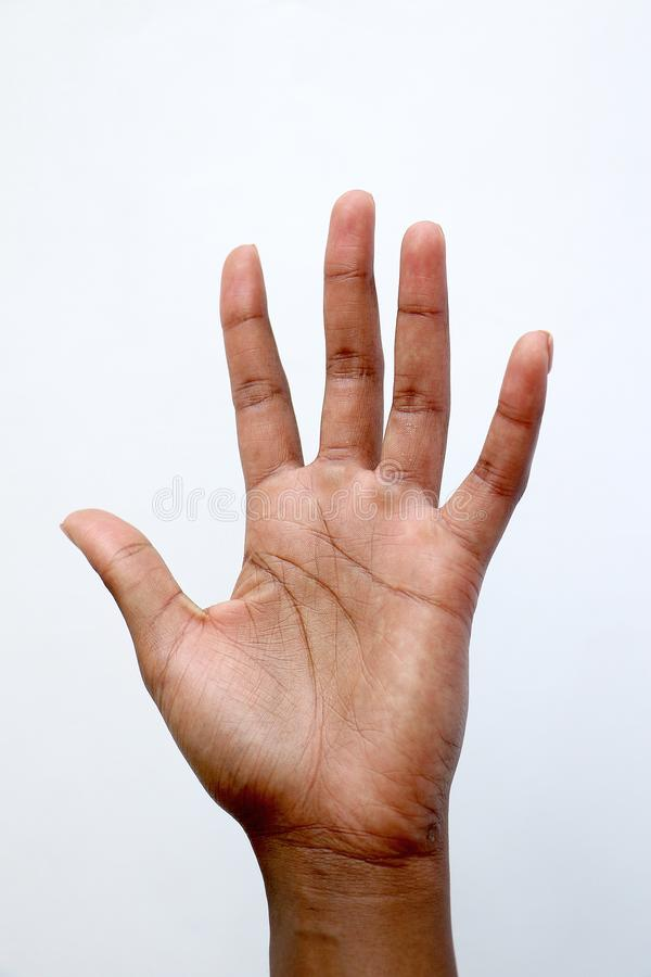 Black African indian hand showing number five, palm of hand stock images