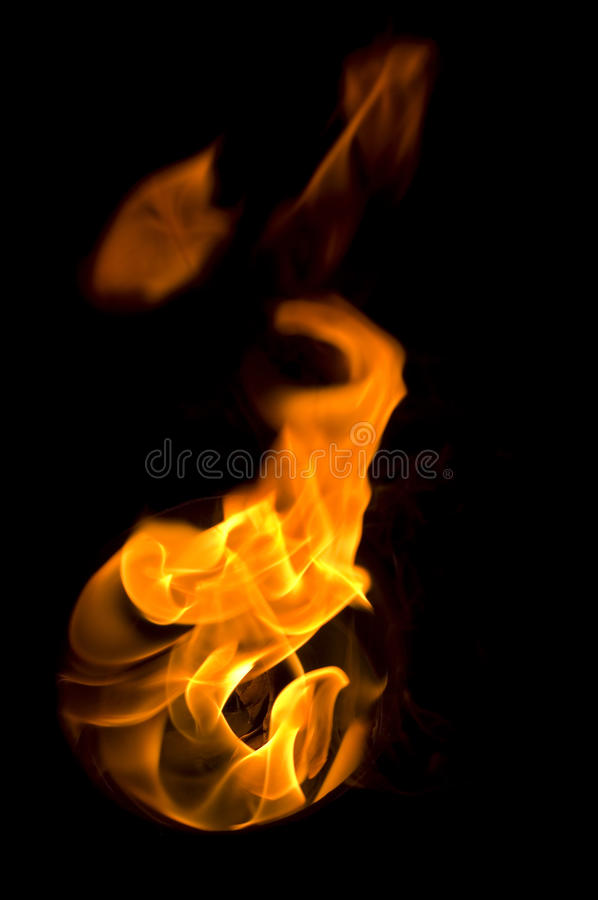 Isolated fire flames on black background, darkness. Fire with a black background, abstract background stock photos