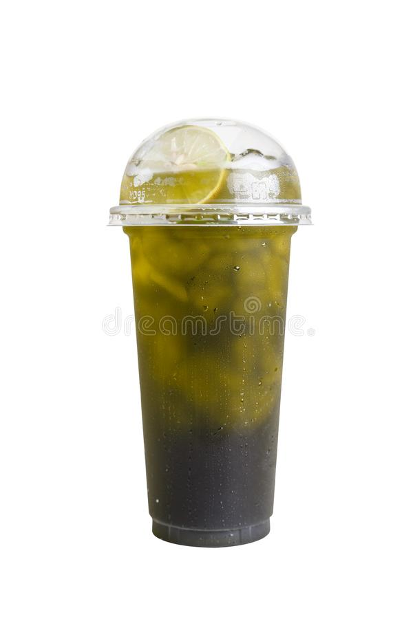 Isolated Front View of Iced Green Tea with lime in plastic cup with plastic cap. Studio shot.  stock images