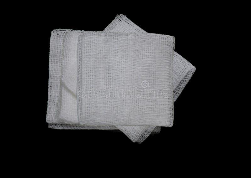 Isolated gauze pads. Gauze pads on the black background royalty free stock photos