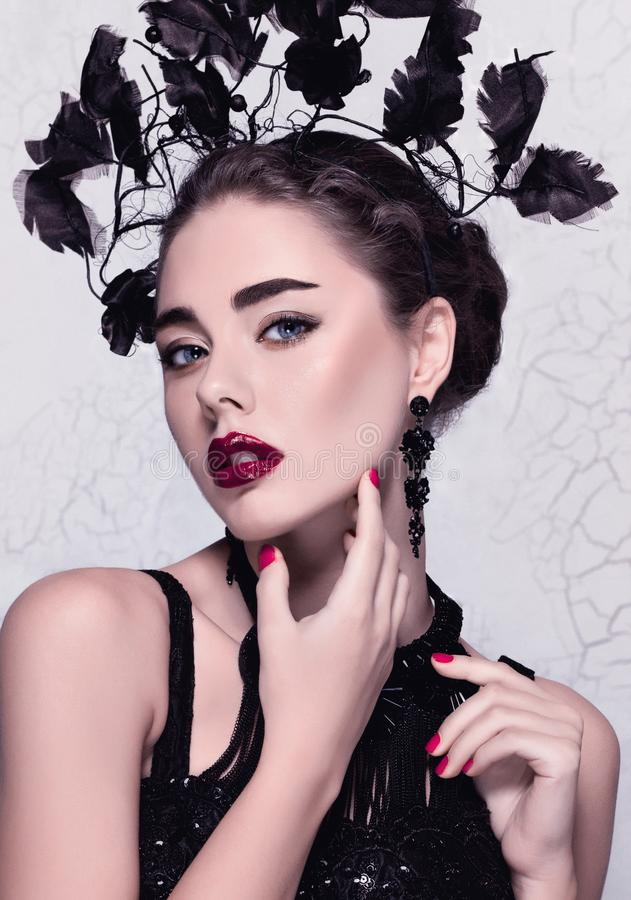 Isolated glamour close-up fashion/beauty portrait of a beautiful caucasian girl wearing perfect make-up and unusual accessories royalty free stock photo