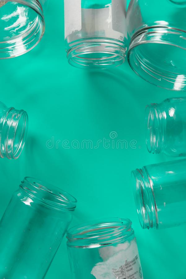 Isolated glass jars, no lids flat, teal mint green background, copy space room. Isolated open glass jars, flat on teal mint green background, blank empty room royalty free stock photography