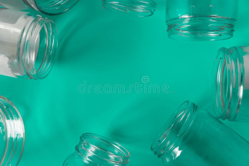 Isolated glass jars, no lids flat, teal mint green background, copy space room. Isolated open glass jars, flat on teal mint green background, blank empty room stock photo