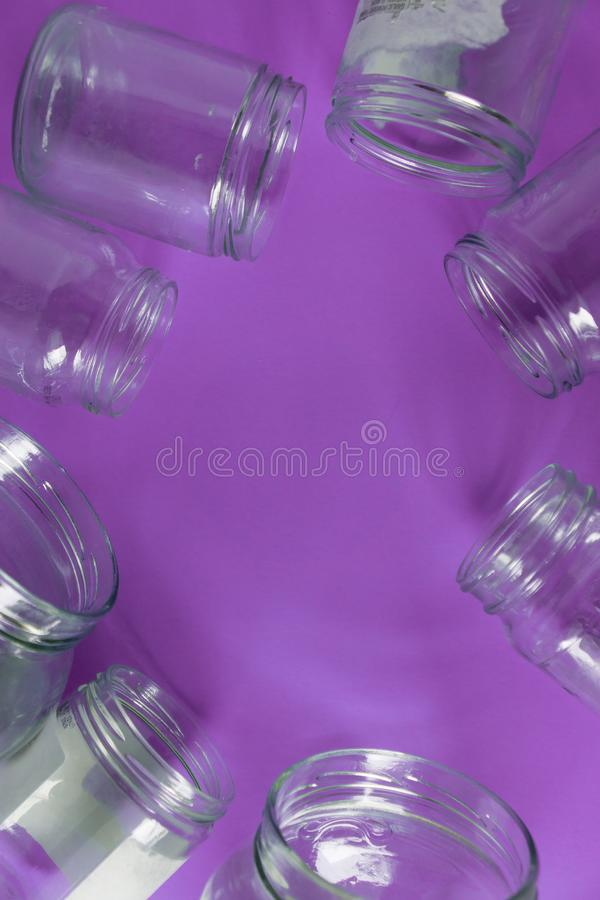 Isolated glass jars, no lids flat, violet purple background, copy space room stock images