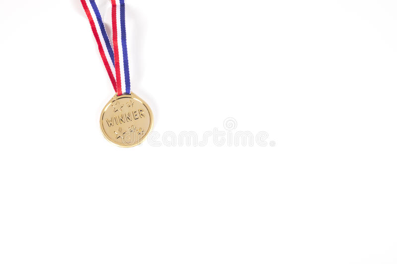 Isolated gold medal on a ribbon royalty free stock photography
